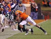 Oct 23, 2010; Charlottesville, VA, USA; Virginia Cavaliers linebacker Ausar Walcott (26) tackles Eastern Michigan Eagles wide receiver Tyrone Burke (9) during the game at Scott Stadium.  Virginia won 48-21. Mandatory Credit: Andrew Shurtleff