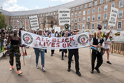 """© Licensed to London News Pictures; 06/09/2020; Bristol, UK. An All Black Lives UK """"Comeback March"""" and rally takes place through Bristol city centre. Organisers of the Bristol protest have encouraged people to bring PPE (personal protective equipment). The All Black Lives group is youth-led and is separate to the Black Lives Matter movement, but both are united in striving for racial equality. All Black Lives UK are holding 'Comeback Marches' at several locations across the country today, including London, Bristol and Manchester, and have issued a series of demands: to end racial discrimination in the criminal justice, reform the education system, end racial health disparities, implement review recommendations, and stand with the Black community in the US. In Bristol the statue of slave trader Edward Colston was pulled down with ropes and thrown into Bristol docks on 07 June during an All Black Lives/Black Lives Matter protest that made headlines around the world. A month later in July a new sculpture titled """"A Surge of Power (Jen Reid) 2020"""" by artist Marc Quinn was put up without permission from Bristol City council. Jen Reid was at the previous protest on 07 June which was in protest for the memory of George Floyd, a black man who was killed on May 25, 2020 in Minneapolis in the US by a white police officer kneeling on his neck for nearly 9 minutes. The killing of George Floyd has seen widespread protests in the US, the UK and other countries. Photo credit: Simon Chapman/LNP."""