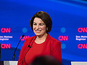 "14 JANUARY 2020 - DES MOINES, IOWA: Senator AMY KLOBUCHAR on stage during the ""photo spray"" at the CNN Democratic Presidential Debate on the campus of Drake University in Des Moines. This is the last debate before the Iowa Caucuses on Feb. 3.    PHOTO BY JACK KURTZ"
