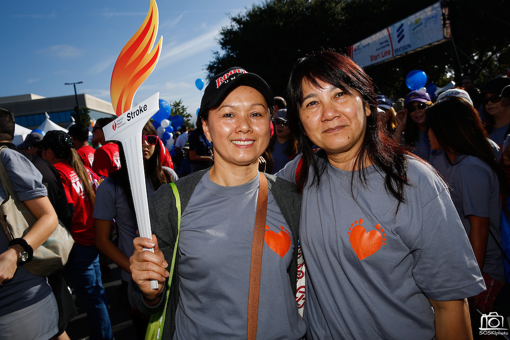 Unidentified participants pose for a portrait during the 2014 Silicon Valley Heart & Stroke Walk at KLA-Tencor in Milpitas, California, on October 11, 2014. (Stan Olszewski/SOSKIphoto)
