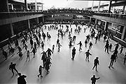Y-640222-08. Crowds on Lloyd Center Ice Rink, Ice Arena, February 22, 1964