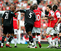 Photo: Tom Dulat.<br /> Arsenal v Bolton Wanderers. The FA Barclays Premiership. 20/10/2007.<br /> El Hadji Diouf(L) of Bolton Wanderers and Cesc Fabregas(second From right) of Arsenal argue. They have been both booked.