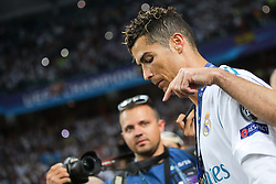 Cristian Ronaldo of Real Madrid and photographer Sandi Fiser after they won 3-1 during the UEFA Champions League final football match between Liverpool and Real Madrid and became Champions League  2018 Champions third time in a row at the Olympic Stadium in Kiev, Ukraine on May 26, 2018.Photo by Morgan Kristan / Sportida