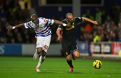 30.12.2012, Loftus Road, London, ENG, Premier League, Queens Park Rangers vs FC Liverpool, 20. Runde, im Bild Liverpool's Jose Enrique in action against Queens Park Rangers' Stephane Mbia during the English Premier League 20th round match between Queens Park Rangers and Liverpool FC at Loftus Road, London, Great Britain on 2012/12/30. EXPA Pictures © 2012, PhotoCredit: EXPA/ Propagandaphoto/ David Rawcliffe..***** ATTENTION - OUT OF ENG, GBR, UK *****
