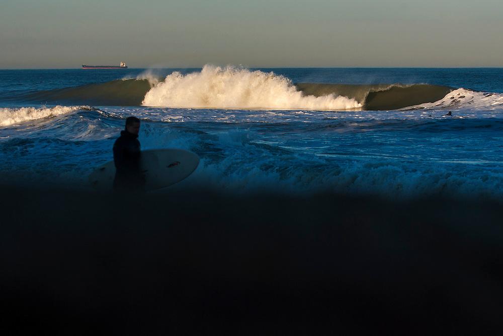 Feb 27, 2013; Virginia Beach; VA; A wave crashes during a swell near 25th Street. Mandatory Credit: Peter J. Casey