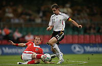 Photo: Rich Eaton.<br /> <br /> Wales v Germany. UEFA European Championships Qualifying. 08/09/2007. Germany's Miroslav Klose escapes the tackle of Wales' James Collins.