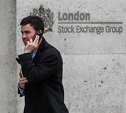 © Licensed to London News Pictures. 09/03/2020. London, UK. A City worker on his phone outside the London Stock Exchange today as markets around the world plunge as fears over the Coronavirus disease continues. Photo credit: Alex Lentati/LNP