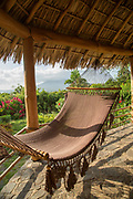 Empty hammock hanging under grass roof at the Totoco Eco Lodge, Ometepe Island, Nicaragua