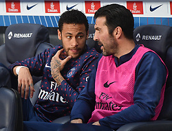 File photo - Paris Saint-Germain's Neymar, wearing a Notre-Dame jersey, and Gianluigi Buffon during the Ligue 1 Paris Saint-Germain (PSG) v Monaco (ASM) on April 21, 2019 at the Parc des Princes stadium in Paris, France. Kylian Mbappe scored a hat-trick and Neymar made his return from a three-month injury lay-off as Paris Saint-Germain began its Ligue 1 title celebrations with a 3-1win over visitorMonaco on Sunday. Paris St Germain sporting director Leonardo is prepared to sell Neymar after the Brazil forward failed to report for pre-season training. Photo by Christian Liewig/ABACAPRESS.COM