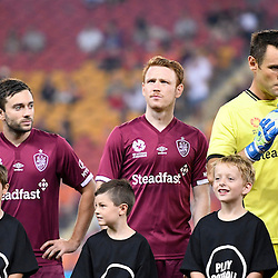 BRISBANE, AUSTRALIA - FEBRUARY 3: Brisbane Roar players Corey Brown, Tommy Oar and Michael Theo line up before the round 18 Hyundai A-League match between the Brisbane Roar and Sydney FC at Suncorp Stadium on February 3, 2017 in Brisbane, Australia. (Photo by Patrick Kearney/Brisbane Roar)