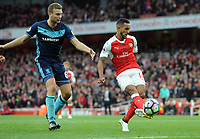 Football - 2016 / 2017 Premier League - Arsenal vs. Middlesbrough<br /> <br /> Theo Walcott of Arsenal and Ben Gibson of Middlesbrough at The Emirates.<br /> <br /> COLORSPORT/ANDREW COWIE