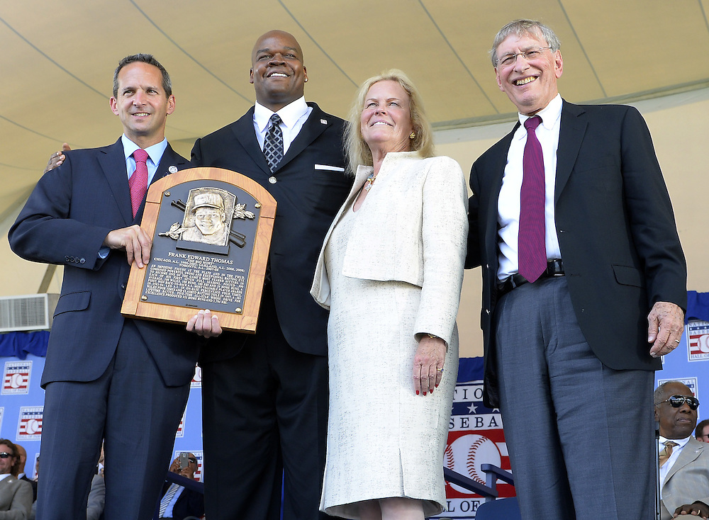 COOPERSTOWN, NY - JULY 27:  2014 Baseball Hall of Famer inductee Frank Thomas poses for a photo with his HOF plaque with Hall of Fame President Jeff Idleson (L), Hall of Fame Chairman Jane Forbes Clark and Baseball Commisioneer Bud Selig (R) during the 2014 induction ceremonies held at the Clark Sports Center in Cooperstown, New York on July 27 2014.