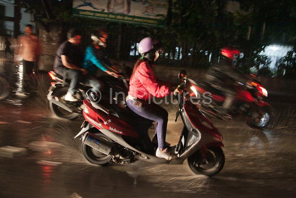 Night time rush hour in Kathmandu in the rain.