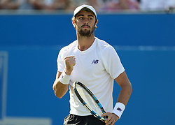 Australia's Jordan Thompson celebrates winning the first set against Great Britain's Andy Murray during day two of the 2017 AEGON Championships at The Queen's Club, London.