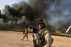 1st Lt. Seth Moulton leads Marines with Charlie Co. 1/4 Marines during a raid on the Najaf home of Mahdi militia leader Moqtada al-Sadr and adjacent buildings - including a school and two small hospitals - used by the militia to stage weapons and fighters. Sadr was not found though materials were removed from the raided locations.