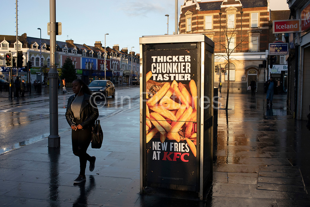 KFC advertising their new type of fries on a wet day in Leytonstone in East London, United Kingdom. Leytonstone is an area of East London, and part of the London Borough of Waltham Forest.