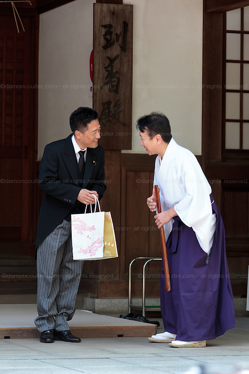 A Japanese politician from the ruling Liberal Democratic party (LDP) visits the shrine during the 70th anniversary celebrations of the end of the Pacific war  at the controversial Yasukuni Shrine in Kudanshita, Tokyo, Japan Saturday August 15th 2015