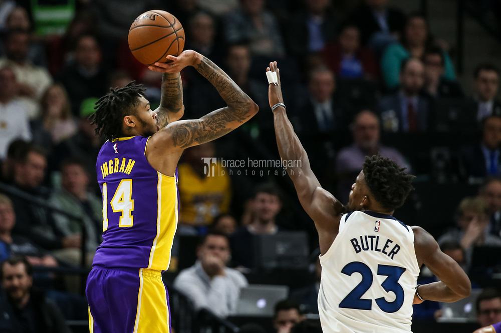 Feb 15, 2018; Minneapolis, MN, USA; Los Angeles Lakers forward Brandon Ingram (14) shoots over Minnesota Timberwolves guard Jimmy Butler (23) at Target Center. Mandatory Credit: Brace Hemmelgarn-USA TODAY Sports