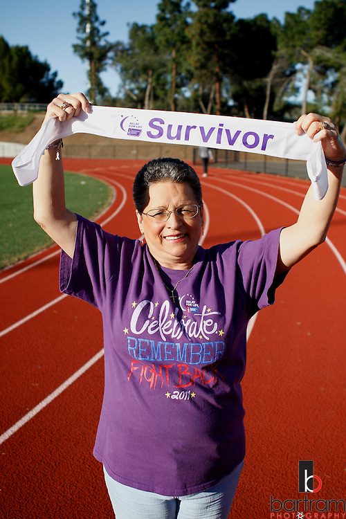 Cancer survivor Margaret Souza poses on the track at Los Medanos College in Antioch on Tuesday, April 17, 2012. Souza was a caregiver for her sister Malia who died from cancer in 2002 then Souza was diagnosed with lung cancer in 2005 and doctors told her she had six months to live. Souza is now cancer free and will participate in this year's Relay for Life. (Photo by Kevin Bartram)