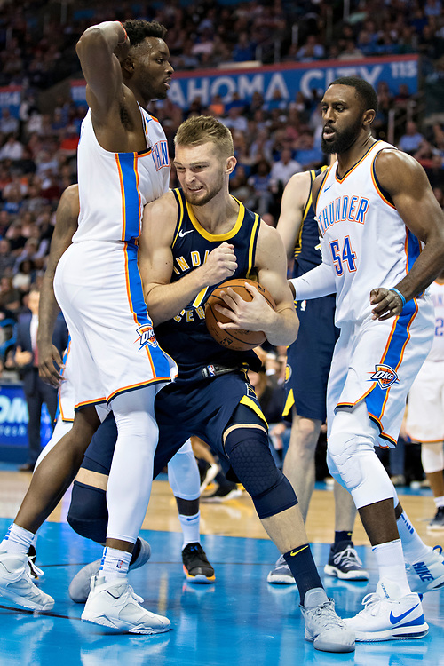 OKLAHOMA CITY, OK - OCTOBER 25:  Domantas Sabonis #11 of the Indiana Pacers tries to go up for a shot against Jeramy Grant #9 of the Oklahoma City Thunder at the Chesapeake Energy Arena on October 25, 2017 in Oklahoma City, Oklahoma.  NOTE TO USER: User expressly acknowledges and agrees that, by downloading and or using this photograph, User is consenting to the terms and conditions of the Getty Images License Agreement.  The Thunder defeated the Pacers 114-96.  (Photo by Wesley Hitt/Getty Images) *** Local Caption *** Jeramy Grant; Domantas Sabonis
