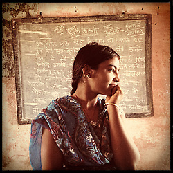 """iPhone portrait of Naaku Maayida, 15, in a village outside of Banswara, Rajasthan, India, April 5, 2013. """"If I would get married it would not feel good. With marriage, children happen, I would have to do the home chores, I would have to fetch water. My parents were illiterate when they had kids,"""" said Maayida.<br /> <br /> Under Indian law, children younger than 18 cannot marry. Yet in a number of India's states, at least half of all girls are married before they turn 18, according to statistics gathered in 2012 by the United Nations Population Fund (UNFPA). However, young girls in the Indian state of Rajasthan—and even a few boys—are getting some help in combatting child marriage. In villages throughout Tonk, Jaipur and Banswara districts, the Center for Unfolding Learning Potential, or CULP, uses its Pehchan Project to reach out to girls, generally between the ages of 9 and 14, who either left school early or never went at all. The education and confidence-building CULP offers have empowered youngsters to refuse forced marriages in favor of continuing their studies, and the nongovernmental organization has provided them with resources and advocates in their fight."""