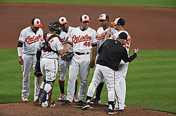 August 31, 2017 - Baltimore, MD, USA - Baltimore Orioles manager Buck Showalter, right, gives the signal to the bullpen for pitcher Mychal Givens to relieve Richard Bleier (48) in the sixth inning against the Toronto Blue Jays at Oriole Park at Camden Yards in Baltimore on Thursday, Aug. 31, 2017. The Blue Jays won, 11-8. (Credit Image: © Kenneth K. Lam/TNS via ZUMA Wire)