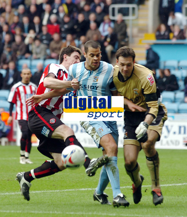 Photo: Kevin Poolman.<br />Coventry City v Sheffield United. Coca Cola Championship. 11/03/2006. Sheffield United's Chris Morgan (L) nearly gets in on goal but is stopped by Coventry defender Marcus Hall and keeper Marton Fulop.