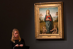 "© Licensed to London News Pictures. 07/12/2016. London, UK. ""The Madonna and Child with the infant Saint John in a landscape"" by Circle of Rafaello Sanzio, called Raphael sold for a hammer price of GBP55k (est. 40-60k) at the Old Masters Evening Sale at Sotheby's in New Bond Street. Photo credit : Stephen Chung/LNP"