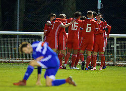 BANGOR, WALES - Tuesday, November 20, 2018: Wales players celebrate the second goal with goal-scorer Sam Bowen (hidden) during the UEFA Under-19 Championship 2019 Qualifying Group 4 match between Wales and San Marino at the Nantporth Stadium. (Pic by Paul Greenwood/Propaganda)