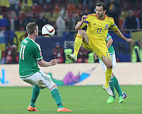 ROMANIA, Bucharest : Romania's  Lucian Sanmartean (R) and Northern Ireland's Chris Brunt (L) vie for the ball during the Euro 2016 Group F qualifying football match Romania vs Northern Ireland in Bucharest, Romania on November 14, 2014.