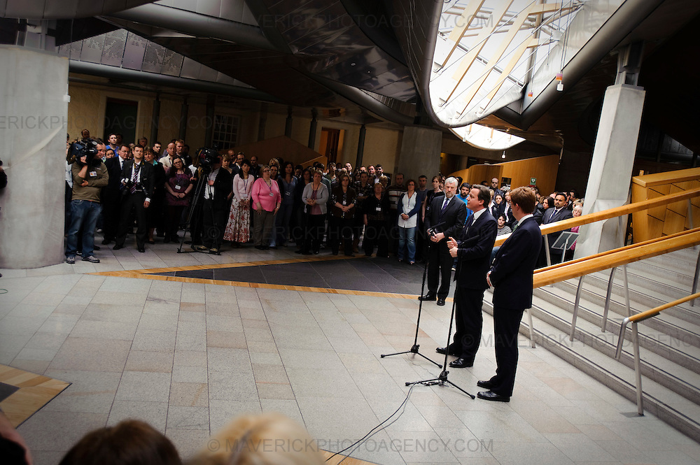 "EDINBURGH, UK - 14th May 2010:  Prime Minister David Cameron paid his first visit as Prime Minister to the Scottish Parliament today calling for a fresh start in relations between the Scots and UK governments.  Speaking on a visit to Holyrood, accompanied at Holyrood by his new Scottish Secretary, Danny Alexander, Mr Cameron also called for an ""agenda of respect"" between the Westminster and Edinburgh parliaments.  (Photograph: Callum Bennetts/MAVERICK)"