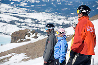 Group of young adults  snowboarding at Kirkwood resort near Lake Tahoe, CA.<br />