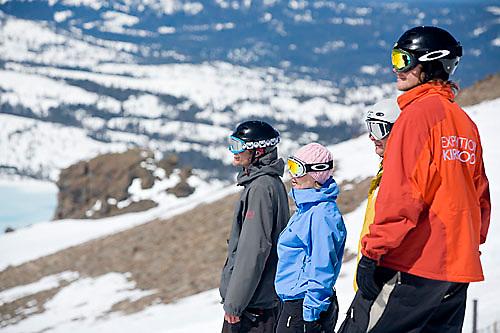 Group of young adults  snowboarding at Kirkwood resort near Lake Tahoe, CA.<br />