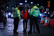 London MET Police seen searching and arresting an anti-Brexit protestor after serving section 14 of British Public Order in a late before mid-night in front of the Houses of Parliament in central London, Wednesday, Aug. 28, 2019. <br /> British Prime Minister Boris Johnson maneuvered on Wednesday to give his political opponents even less time to block a no-deal Brexit before the Oct. 31 withdrawal deadline, winning Queen Elizabeth II's approval to suspend Parliament. (Photo/Vudi Xhymshiti)
