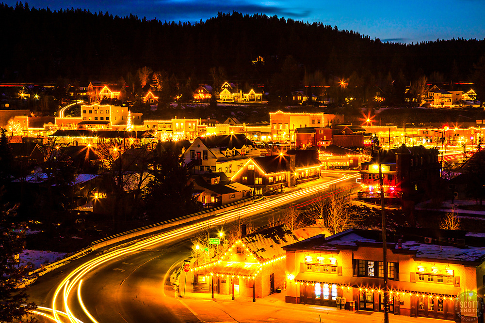 """""""Downtown Truckee 76"""" - Sunset photograph of historic Downtown Truckee, California. Shot during the holidays with snow in the foreground."""