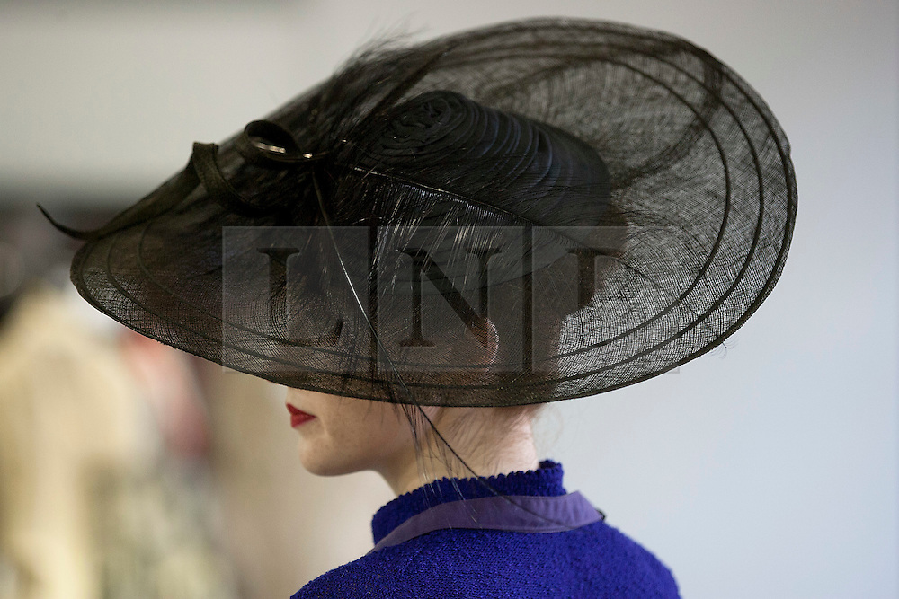 © Licensed to London News Pictures. 25/06/2012. LONDON, UK. A member of staff at Kerry Taylor Auctions models a hat previously worn by Kate Middleton on the occasion of the wedding of Harry Meade in the company of H.R.H. Prince William. The hat is being sold as part of an auction of over 250 lots of fine haute couture, accessories and textiles and is expected to fetch £1000 - 1500. Photo credit: Matt Cetti-Roberts/LNP