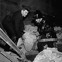 Two firemen searching the rubble are pictured with the granite head from the statue of Horatio Lord Nelson. March 8, 1966. (Part of the Independent Newspapers/NLI Collection)