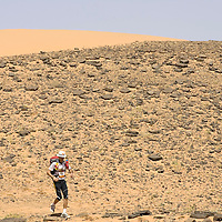 25 March 2007: Runner #70 Olivier Bonnassiolle of France runs between Irhs and Khermou during the first stage of  the 22nd Marathon des Sables, a 6 days and 151 miles endurance race with food self sufficiency across the Sahara Desert in Morocco. Each participant must carry his, or her, own backpack containing food, sleeping gear and other material.