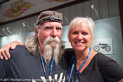 Mailman Kevin O'Brien with his mailman wife Cheryl at the Old Iron - Young Blood exhibition media and industry reception in the Motorcycles as Art gallery at the Buffalo Chip during the annual Sturgis Black Hills Motorcycle Rally. Sturgis, SD. USA. Sunday August 6, 2017. Photography ©2017 Michael Lichter.