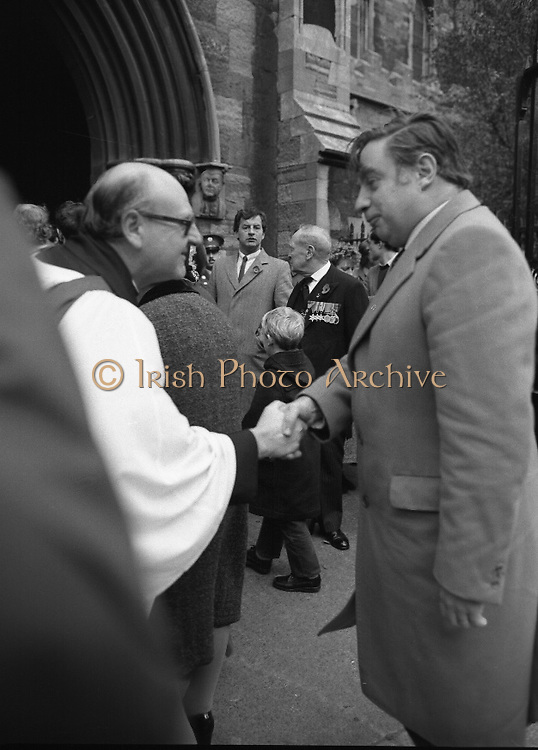 Remembrance Day Service.1983.13.11.1983.11.13.1983.13th November 1983..A remembrance service was held in St Patrick's Cathederal, Dublin,(Poppy Day) to commerate the Irish Fallen who died  whilst on service with the British Army in the two World Wars. .Picture of Mr Peter Sutherland,S.C,Attorney General,being greeted at the service By Dean Griffin.