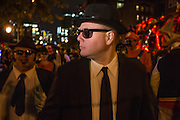 New York, NY, October 31, 2013. A man costumed as Elwood Blues, of the fictional Blues Brothers, with Jake Blues to his left, in the Greenwich Village Halloween Parade.