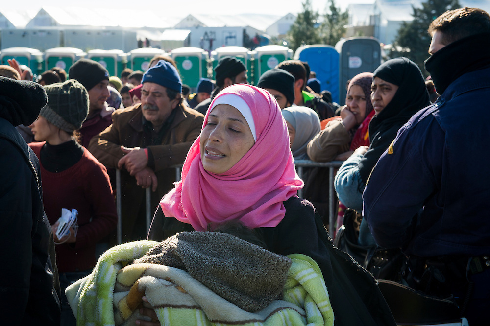 March 5, 2016 - Idomeni, Greece: Desperate pregnant woman with small child hears she has to wait hours in a overcrowded tent before the border crossing. Make shift camp at the  Idomeni border crossing in Greece. 13,000 refugees are stuck here after Macedonia closed the border. New arrivals come in every day, making living conditions more and more difficult, so that the local government asked the emercency state was declared . (Steven Wassenaar/Polaris)