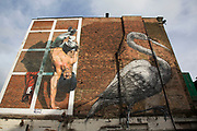 Street art near Brick Lane in the East End of London. Martin Ron painted the left hand side of the famous Hanbury Street wall which currently plays host to the long standing and highly regarded ROA Crane. The street is renowned as only hosting the very best street artists.
