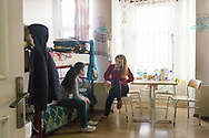 Syrian Christians Razan Karoni (right) with her friend Bernadette, 13, in their shared bedroom opposite the Samatya Kilisesi (church) in Istanbul, Turkey. Razan is waiting in Istanbul before being resettled to Australia