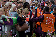 Game Maker volunteers control crowds of spectators in the Olympic Park during the London 2012 Olympics. This land was transformed to become a 2.5 Sq Km sporting complex, once industrial businesses and now the venue of eight venues including the main arena, Aquatics Centre and Velodrome plus the athletes' Olympic Village. After the Olympics, the park is to be known as Queen Elizabeth Olympic Park.