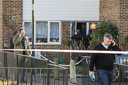 © Licensed to London News Pictures. 15/02/2018. London, UK. Police detectives speak with local residents on Goldwing Close, East London, where a 17-year-old boy was fatally stabbed. Police and London Ambulance Service attended but the victim was pronounced dead at the scene. A murder investigation has been launched. Photo credit: Rob Pinney/LNP