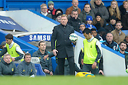 Ronald Koeman, the Southampton manager holding on to the match ball before a throw in is taken. Barclays Premier league match, Chelsea v Southampton at Stamford Bridge in London on Sunday 15th March 2015.<br /> pic by John Patrick Fletcher, Andrew Orchard sports photography.