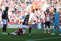 Football - 2017 / 2018 Premier League - Southampton vs. Manchester United<br /> <br /> Southampton's Oriol Romeu holds his knee after putting a chance narrowly wide at St Mary's Stadium Southampton<br /> <br /> COLORSPORT/SHAUN BOGGUST