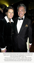 MR DAVID TANG the Hong Kong multi millionaire and MISS LUCY WASTNAGE at a reception in London on 13th November 2001.OUD 16