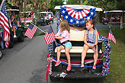 Young children wait for the start of the annual Sullivan's Island Independence Day parade July 4, 2017 in Sullivan's Island, South Carolina. The tiny affluent sea island hosts a bicycle and golf cart parade through the historic village.